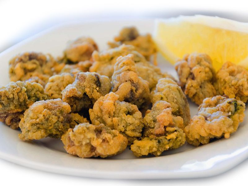 Comer ortiguillas prefritas en Huelva