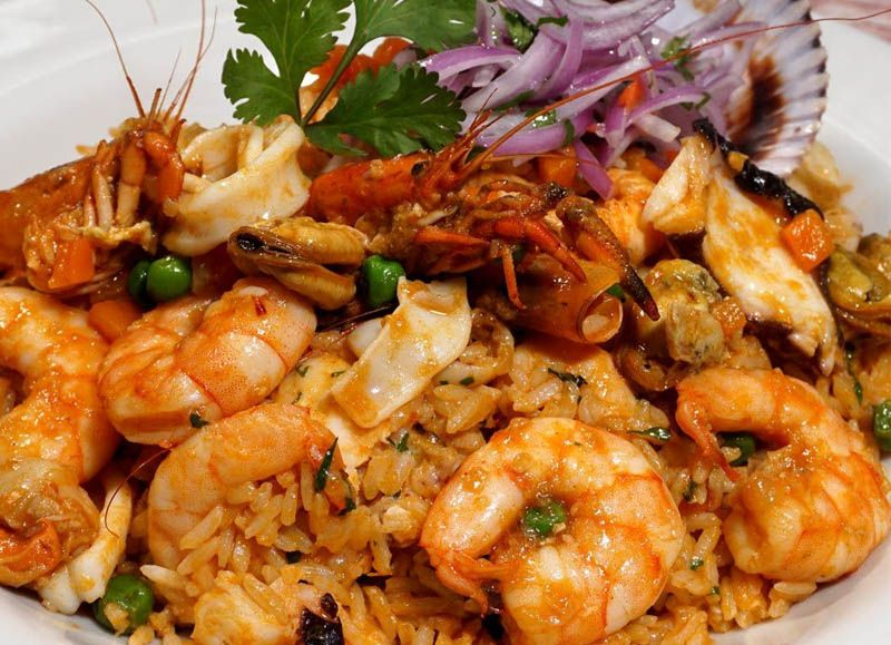 Prueba el exquisito arroz con mariscos